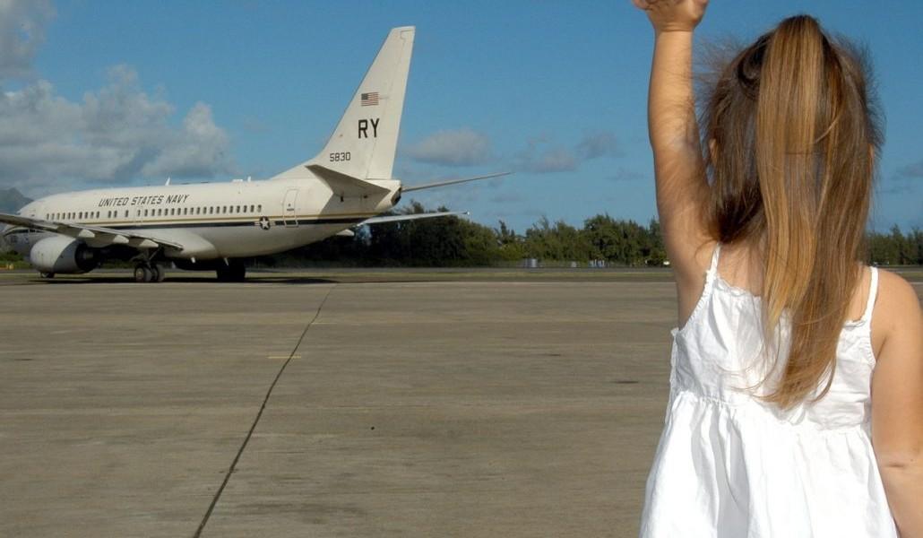 child-waving